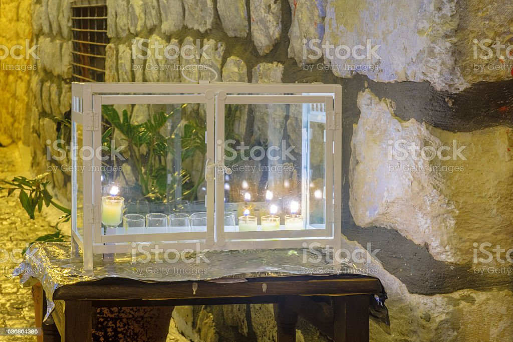 Traditional Menorah (Hanukkah Lamp) with olive oil candles stock photo