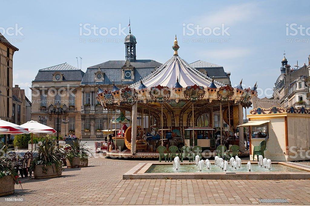 Traditional merry-go-round on town square stock photo