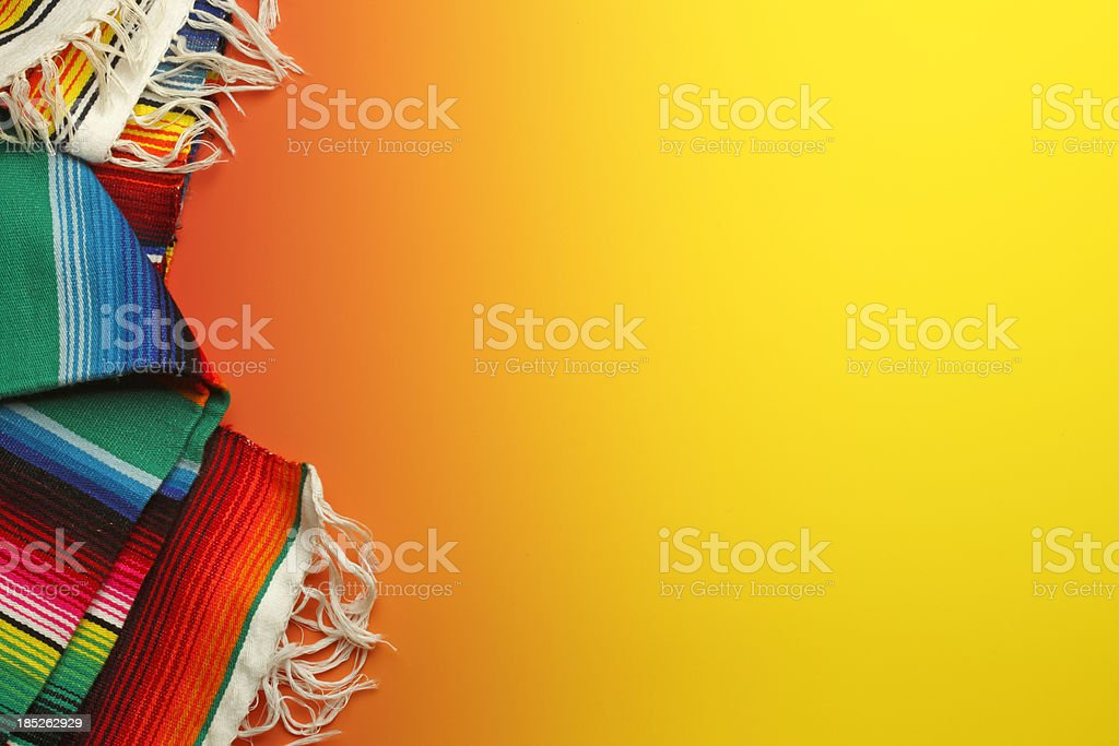 Traditional Mexican blankets on a colorful yellow background royalty-free stock photo
