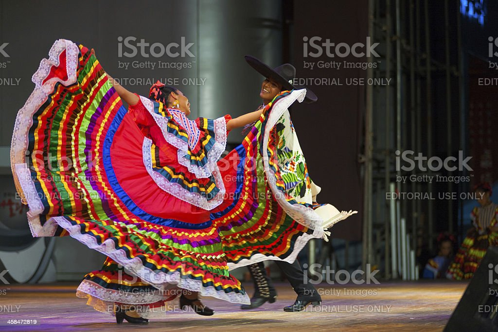 Traditional Mexican Dancer Red Dress Spreading stock photo