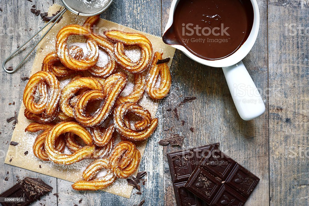 Traditional mexican dessert churros with chocolate sause. stock photo