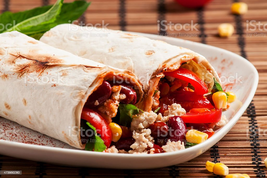 Traditional Mexican food, burritos with meat and beans, selectiv stock photo