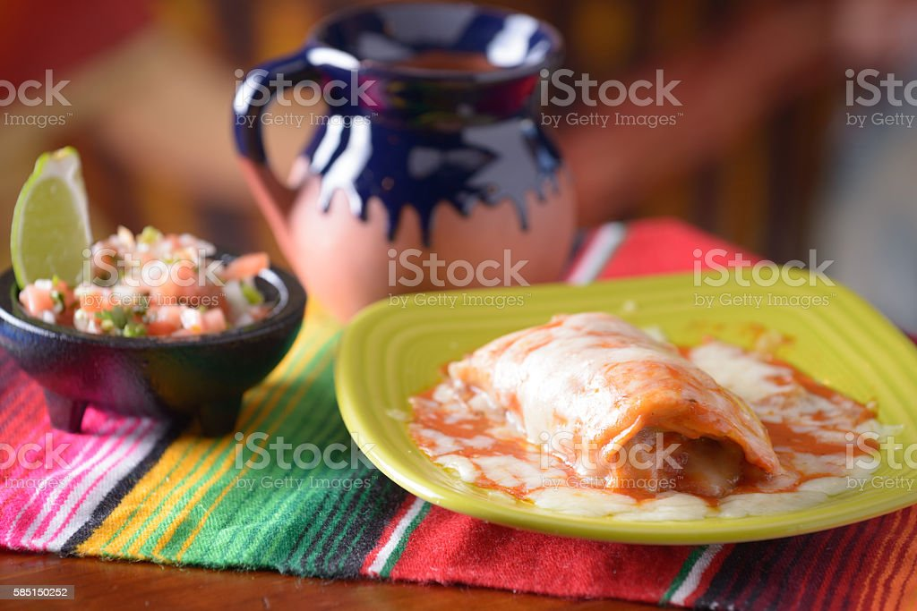 Traditional Mexican food enchilada with coffee and salsa stock photo