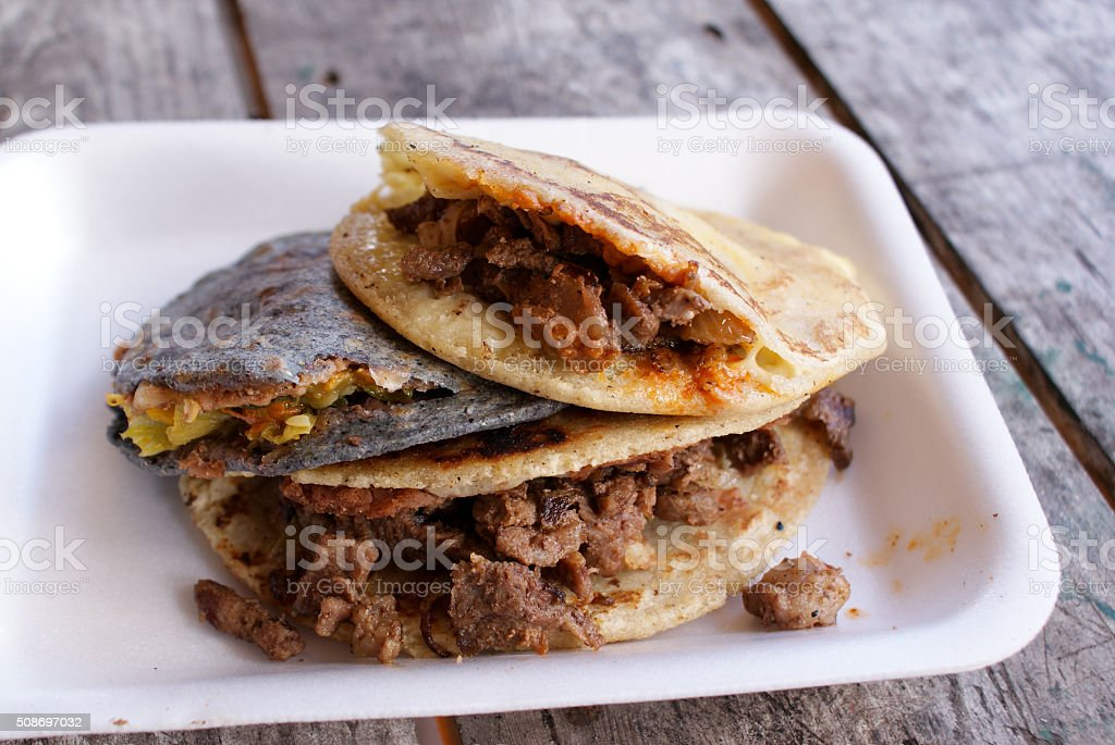 Traditional Mexican Gorditas stuffed with various filling stock photo