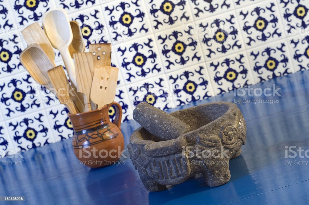 Traditional Mexican wooden spoons, mortar and tiles stock photo