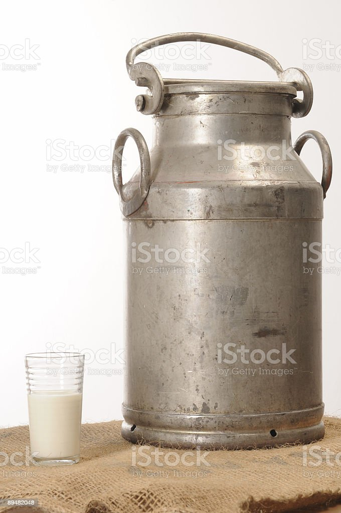Traditional milk container with glass royalty-free stock photo