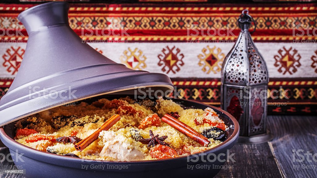 Traditional moroccan tajine of chicken with dried fruits and spi stock photo