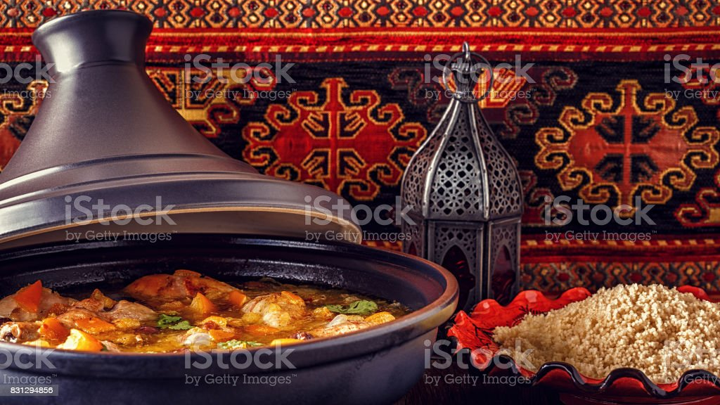 Traditional moroccan tajine of chicken with salted lemons, olives. stock photo
