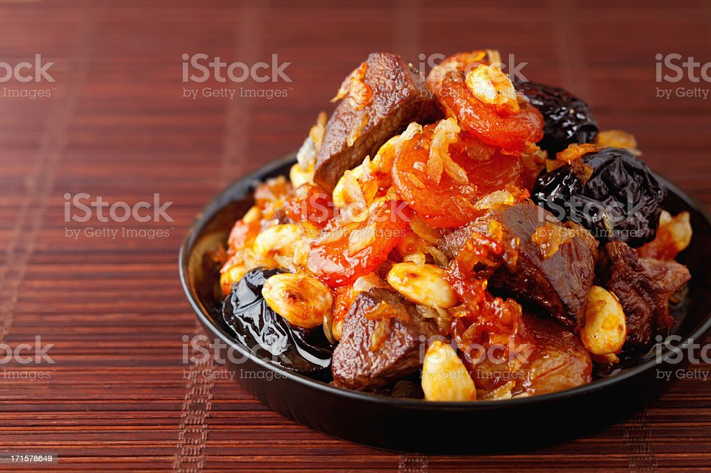 Traditional Moroccan Tajine served in shallow bowl stock photo