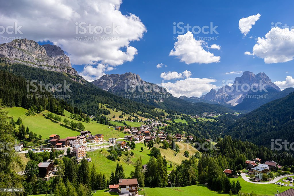 Traditional mountain villages with majestic mountains in background. stock photo
