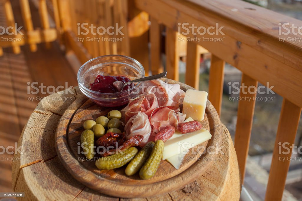 Traditional mountain wooden plate of italian lunch stock photo