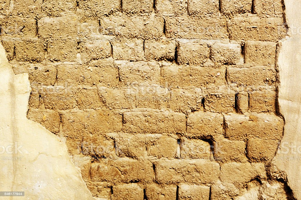 Traditional mud brick wall makes textured background stock photo