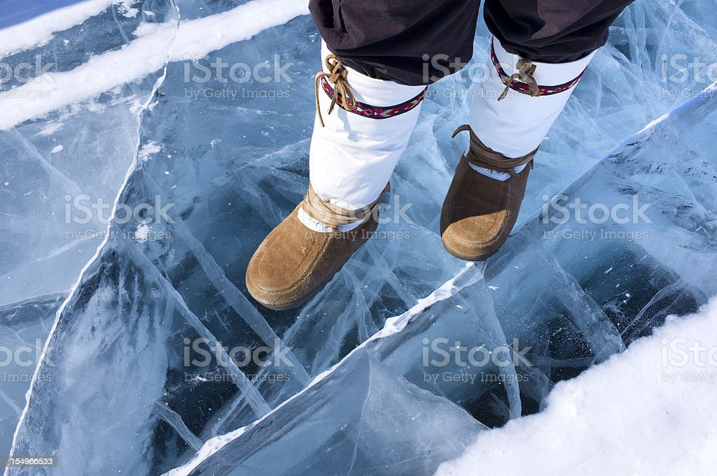 Traditional Mukluks or boots on ice. stock photo