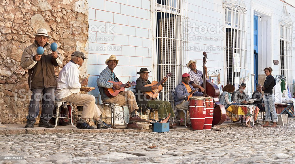 Traditional musicians playing on the streets in Trinidad, Cuba. stock photo