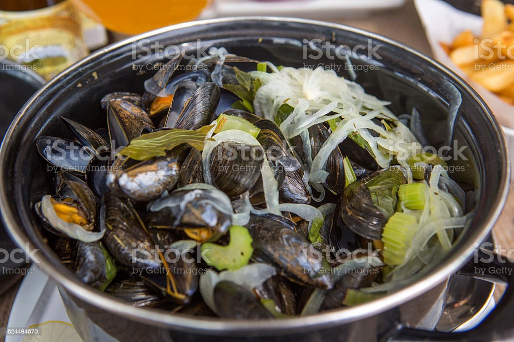 traditional mussel pot dish with celery at calais france stock photo