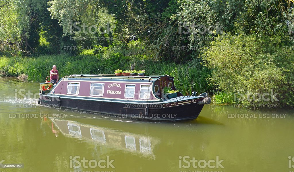 Traditional Narrow boat on the river Ouse stock photo