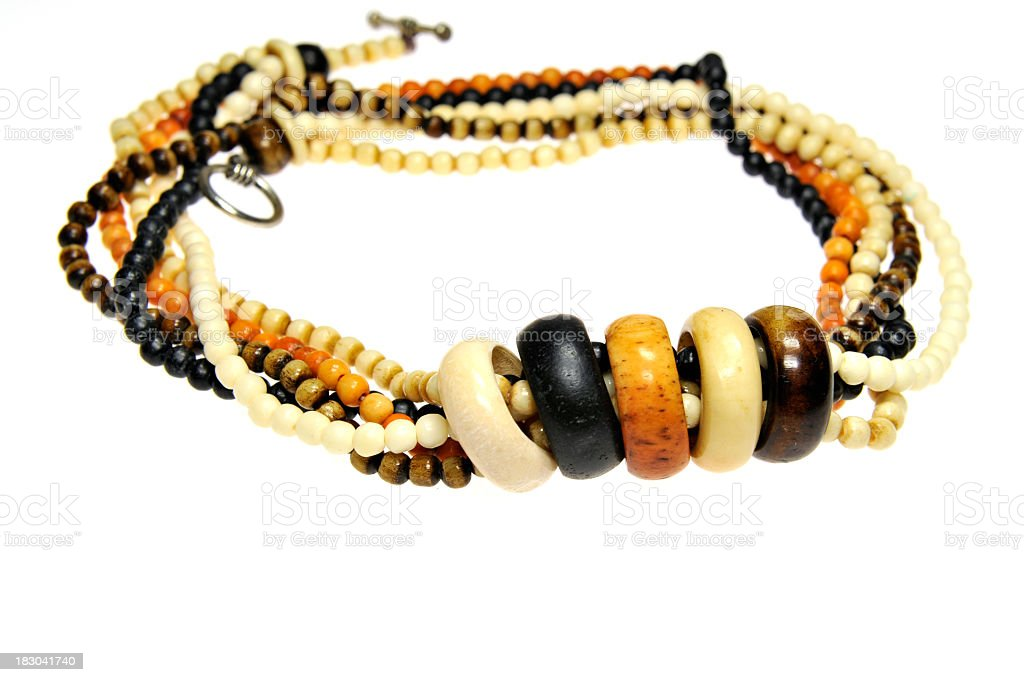 Traditional necklace with stone beads and rings on white background. stock photo