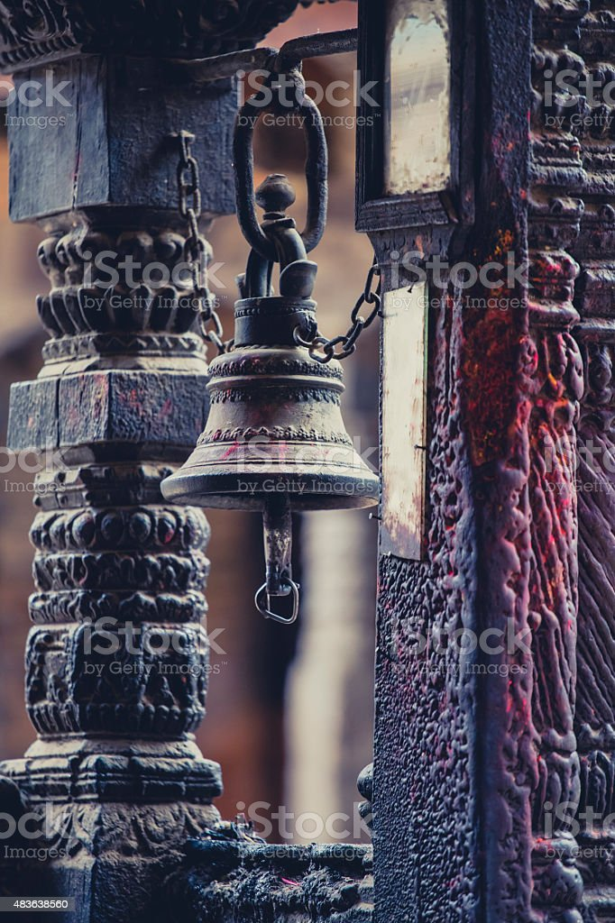 Traditional Nepalese bell in a very old and small temple stock photo