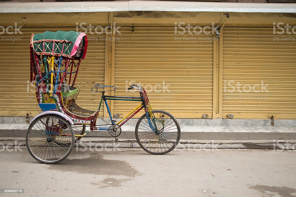 Traditional nepalese rickshaw parked on the street stock photo