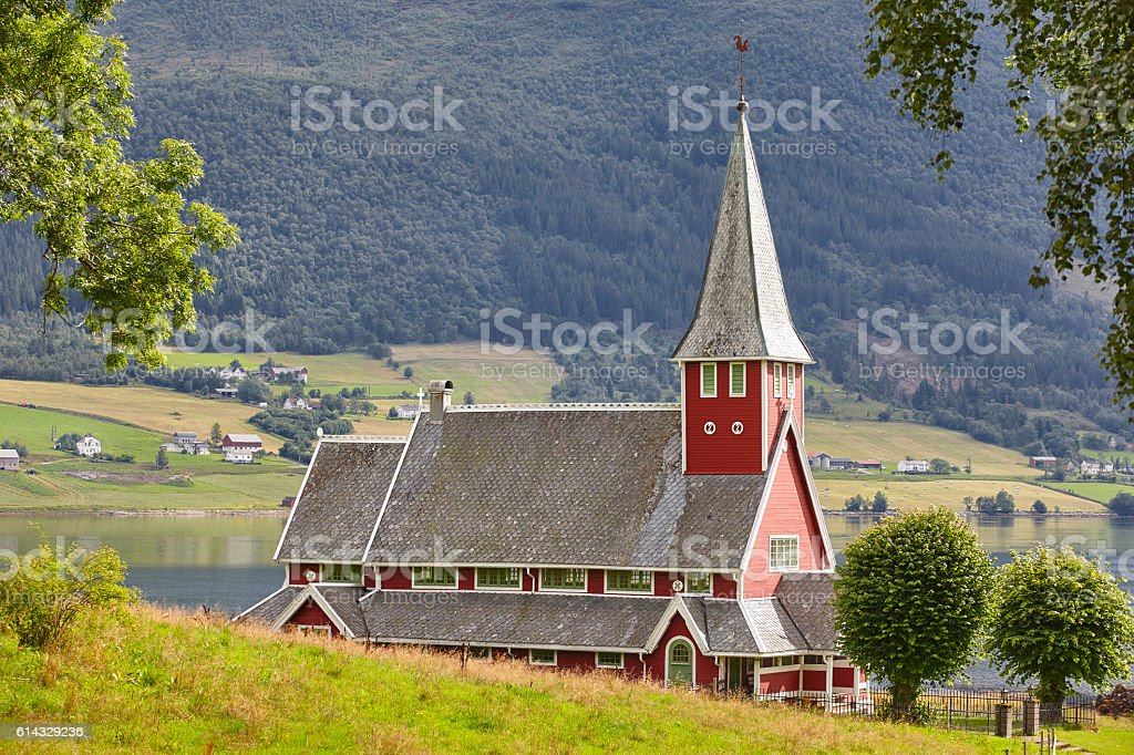 Traditional norwegian red stave church. Rodven. Travel Norway. stock photo
