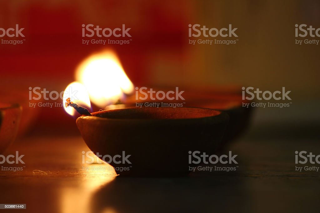 Traditional oil lamps lit on the occasion of Diwali festival stock photo