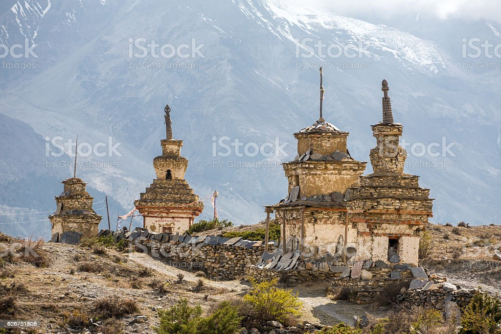 Traditional old Buddhist stupas on Annapurna Circuit Trek stock photo