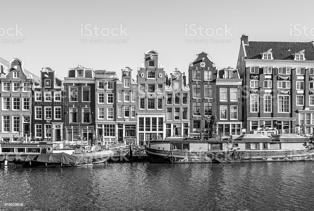 Traditional old building facades at the canals in Amsterdam stock photo