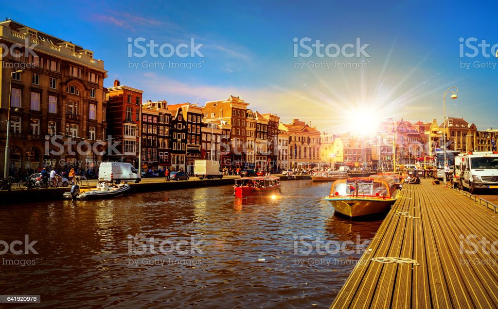 Traditional old buildings and boats in Amsterdam, Netherlands. stock photo