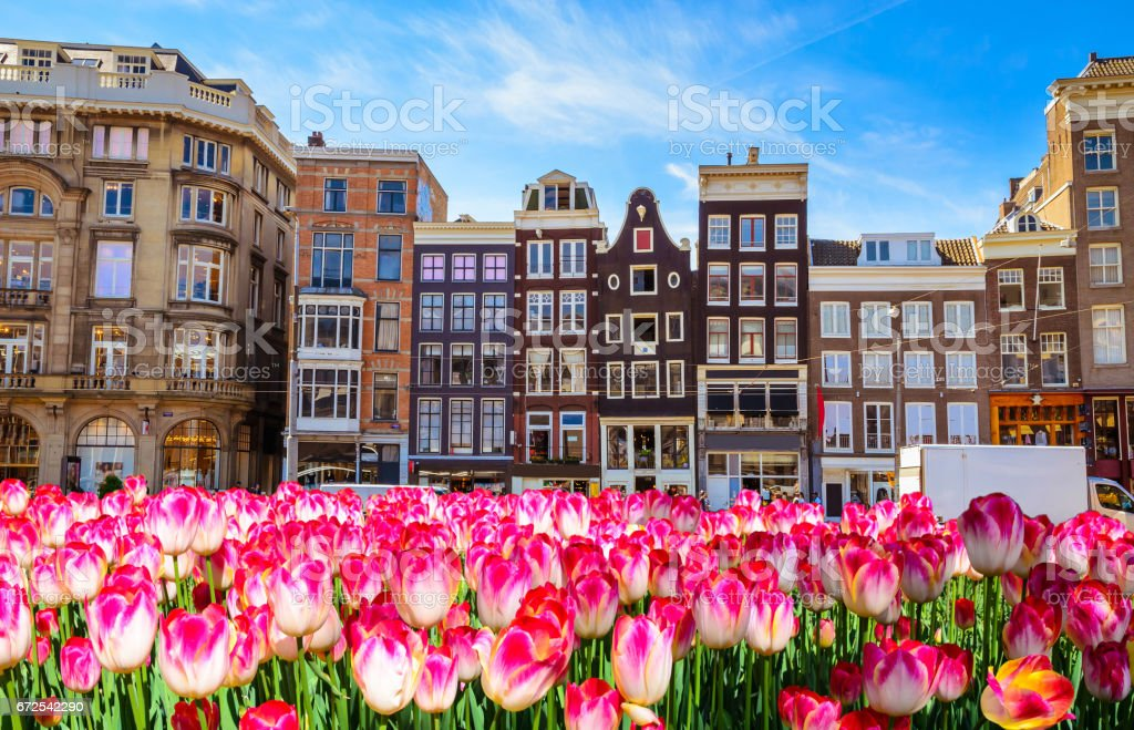 Traditional old buildings and boats in Amsterdam, Netherlands stock photo