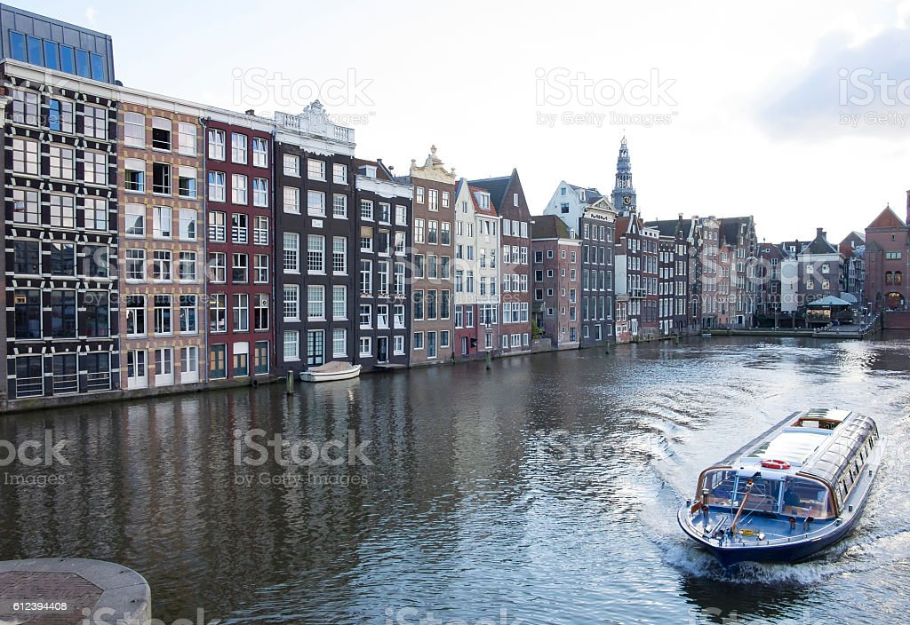 Traditional old buildings at a canal in Amsterdam, the Netherlands stock photo