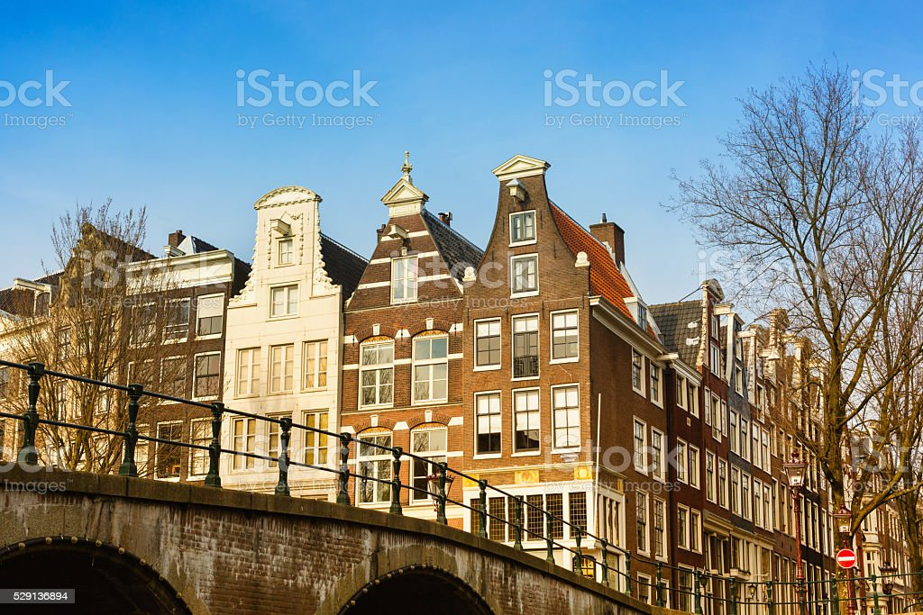 Traditional old houses and bridge in Amsterdam, Netherlands stock photo