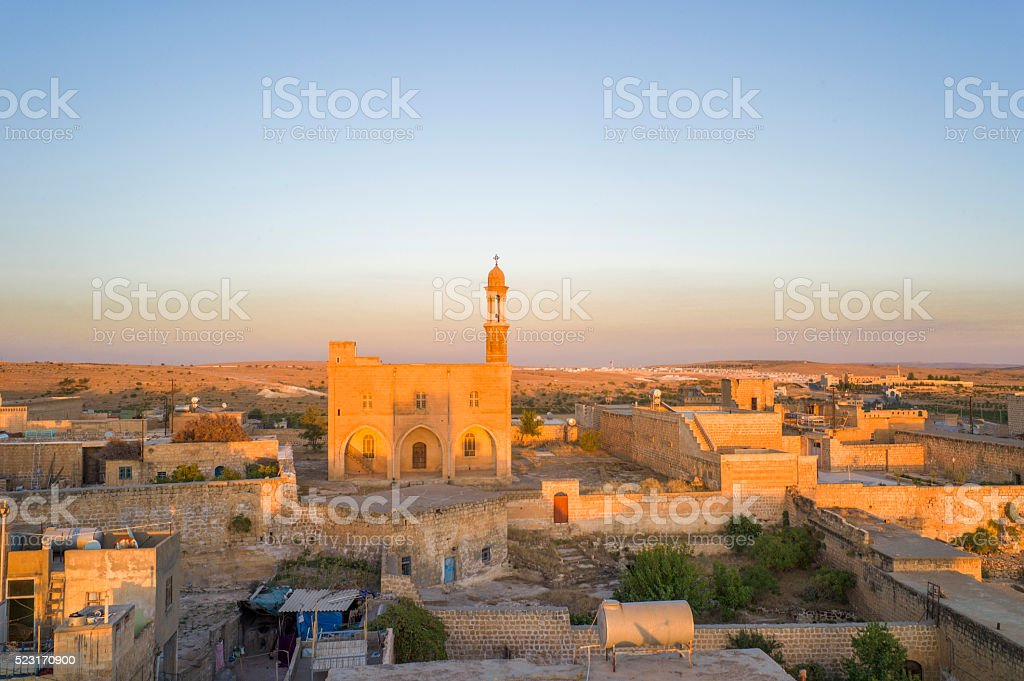 traditional old houses and church at midyat mardin turkey stock photo