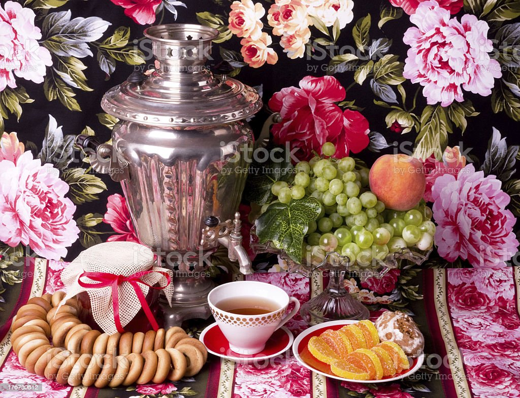 Traditional old Russian tea kettle with bagels and marmalades stock photo