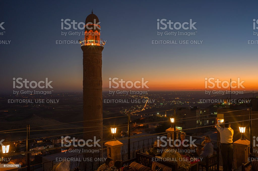 traditional old stone minaret during sunset of mardin turkey stock photo