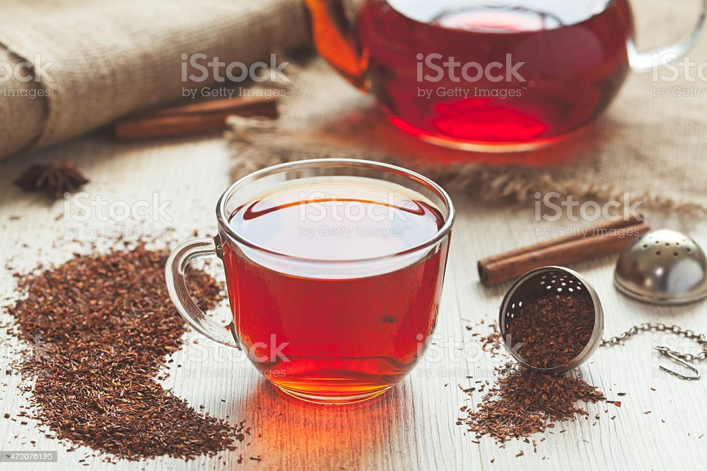 Traditional organic rooibos tea in rustic style with faded instagram stock photo
