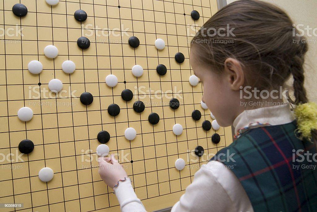 Traditional oriental logic game GO stock photo