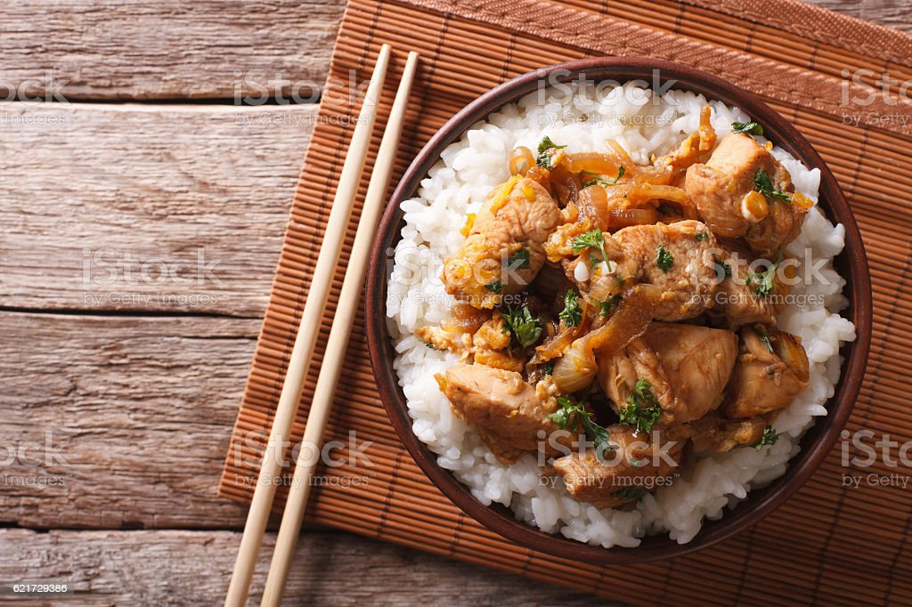 Traditional oyakodon and rice in a bowl. horizontal top view stock photo