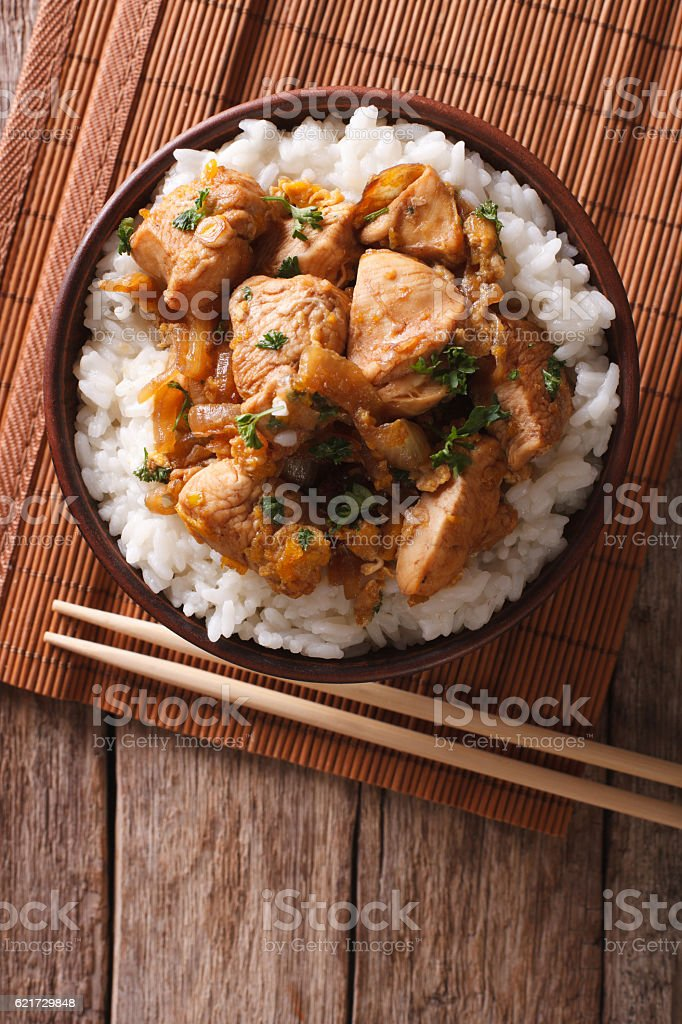 Traditional oyakodon and rice in a bowl. vertical top view stock photo