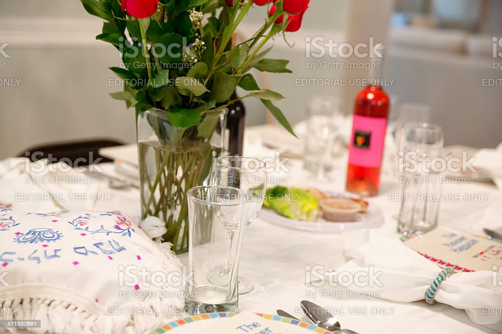 Traditional Passover Seder Table with Haggadah royalty-free stock photo