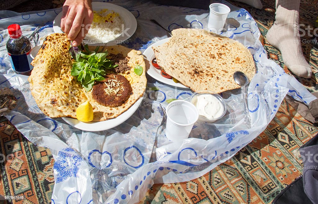 Traditional Persian Lunch on the carpet in Iran stock photo