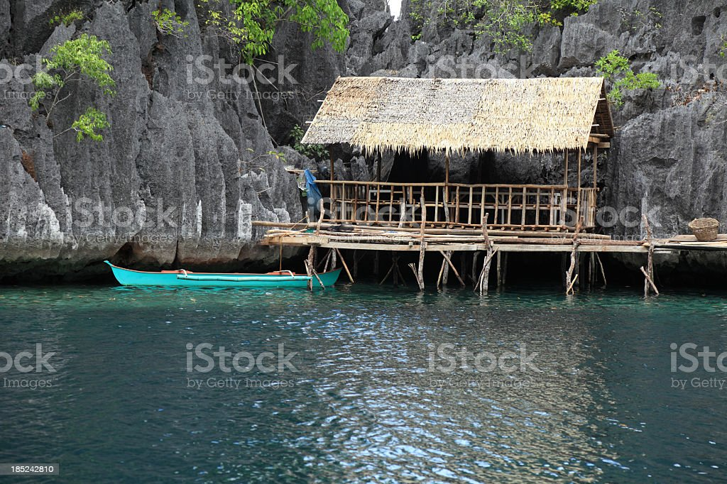 Traditional Philippine house and a boat stock photo