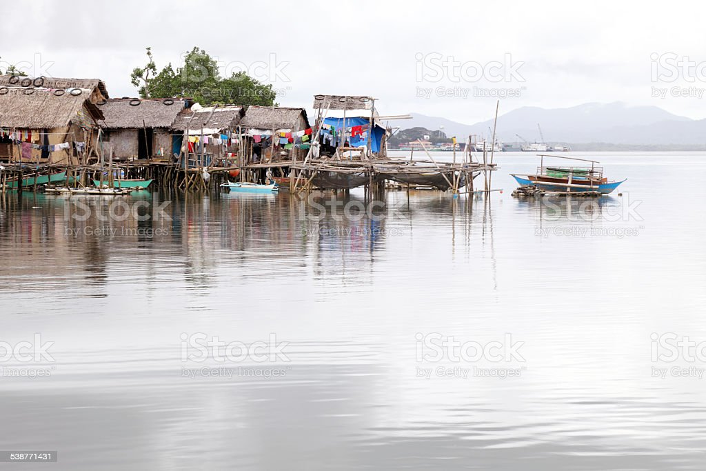 Traditional Philippine village on the water stock photo
