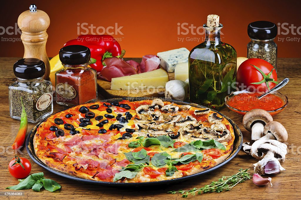 Traditional pizza and ingredients stock photo