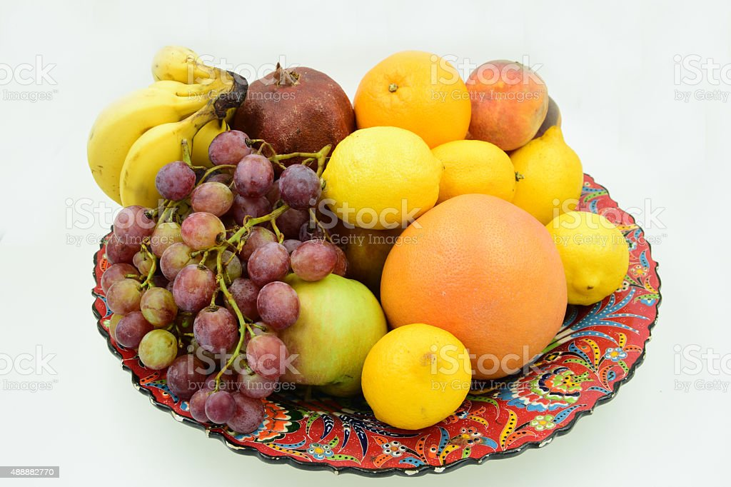 Traditional plate filled with fruits stock photo