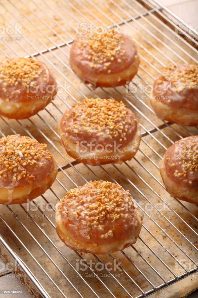 Traditional Polish homemade donuts with liqueur and walnuts stock photo