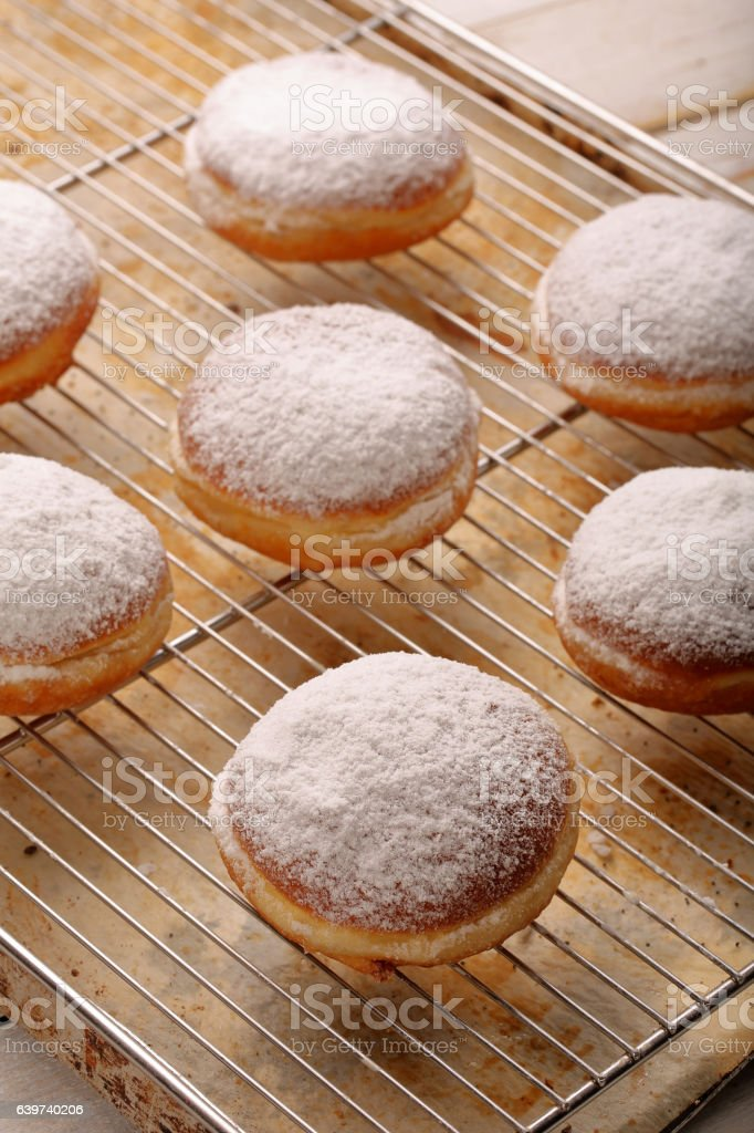 Traditional Polish homemade donuts with liqueur on Fat Thursday stock photo