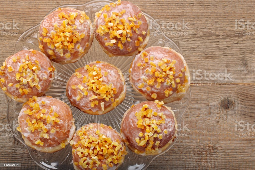 Traditional Polish homemade donuts with rose liqueur and orange stock photo