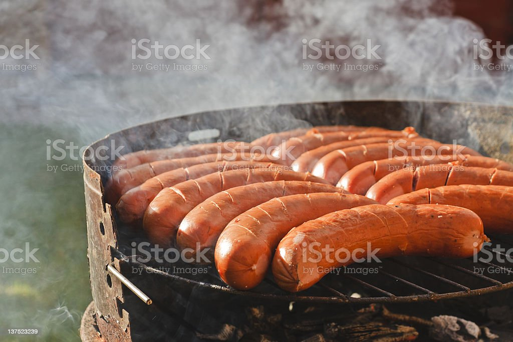 Traditional Polish Sausages on Barbecque Grill royalty-free stock photo