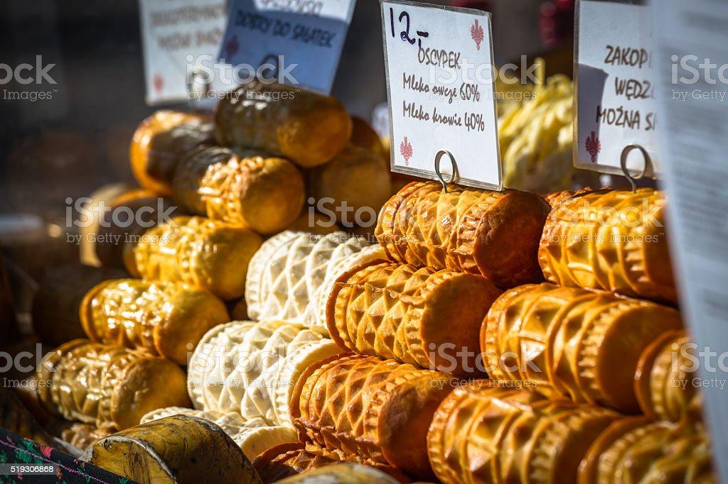 Traditional polish smoked cheese oscypek on outdoor market in Za stock photo