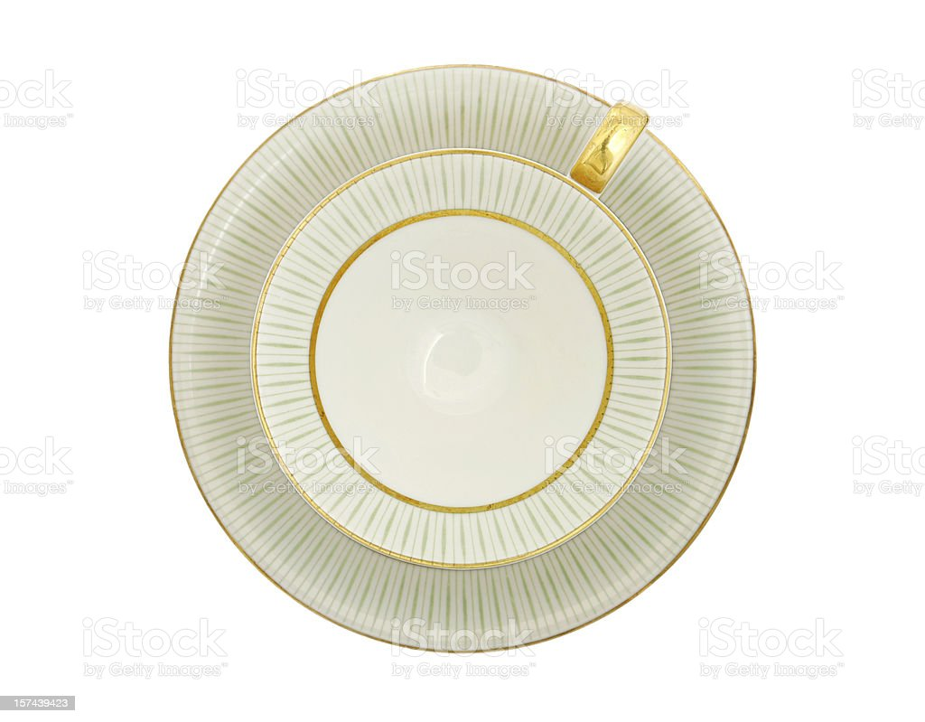 Traditional porcelain tea cup top view, gold and green pattern stock photo
